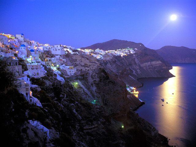 moonrise over santorini greece