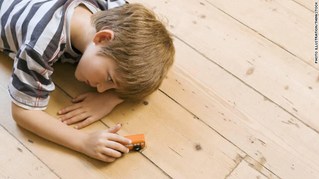 111108082205-boy-child-playing-car-floor-autism-story-top